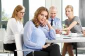 Attractive businesswoman sitting at meeting — Stock Photo