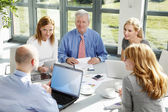Business people discussing in meeting — Stock Photo