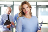 Businesswoman sitting at business meeting — Stock Photo