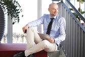 Businessman sitting at staircase — Stock Photo