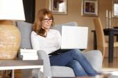 Businesswoman at home with laptop — Stock Photo