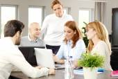 Business people sitting around conference table — Stock Photo