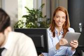 Businesswoman analyzing data on tablet — Stock Photo
