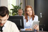 Businesswoman sitting in front of computer — Stock Photo