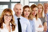 Business people standing in a row — Stock Photo