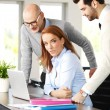Businesswoman constulting with business team — Stock Photo #70205833