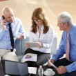 Businesswoman consulting with business people at meeting — Stock Photo #70206631