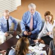 Business people sitting at meeting — Stock Photo #70206853