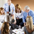 Business people sitting at meeting — Stock Photo #70206877