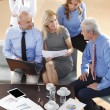 Business people sitting at meeting — Stock Photo #70206897