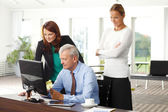 Sales team working on laptop at office — Stock Photo