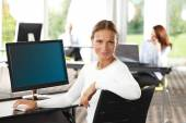 Middle age businesswoman at office — Stock Photo
