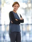 Businesswoman with arms crossed at office — Stock Photo