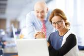Business people working at laptop — Stock Photo