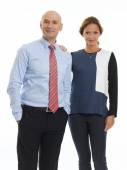 Middle age businesswoman and senior businessman — Stock Photo