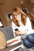 Businesswoman typing on her cellphone — Stock Photo