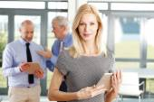 Businesswoman holding digital tablet at office — Stock Photo
