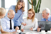 Sales team analyzing financial data at meeting — Stock Photo