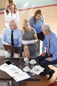 Business people sitting at meeting — Stock Photo