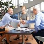 Businessmen shaking hands — Stock Photo #70836379