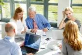 Business people sitting at office — Stock Photo
