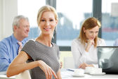 Businesswoman sitting at meeting — Stock Photo