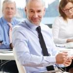 Senior sales man sitting at office — Stock Photo #71682607