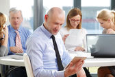 Middle age businessman sitting at office — Stock Photo