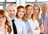 Business people standing in row — Stock Photo