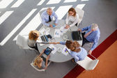 Business people around conference desk — Stock Photo