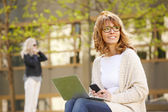 Businesswoman sitting at outdoor — Stock Photo