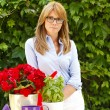 Woman working at flower shop — Stock Photo #73276147