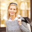 Smiling woman with shopping bags — Stock Photo #73276323