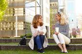 Two mature businesswomen drinking coffee — Stock Photo