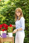 Woman standing at home and gardening — Stock Photo