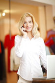 Woman in her shop making call — Stock Photo