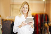 Clothing store owner businesswoman — Stock Photo