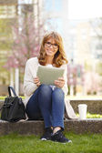Businesswoman in front of an office have break — Stock Photo