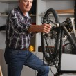 Man standing in his workshop — Stock Photo #75382865