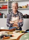 Carpenter sitting at his workshop — Stock Photo