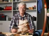 Retired carpenter sitting at workshop — Stock Photo