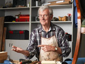 Carpenter sitting in his workshop — Stock Photo