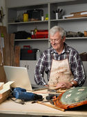 Smiling senior carpenter — Stock Photo
