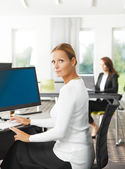 Sales woman sitting at office — Stock Photo