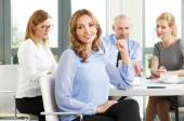 Businesswoman sitting in office — Stock Photo