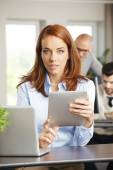 Sales woman behind laptop — Stock Photo