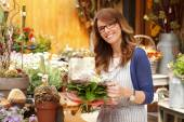 Smiling florist woman — Stock Photo