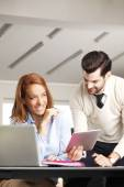 Businessman consulting with executive businesswoman — Stock Photo
