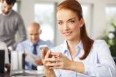Executive businesswoman holding mobile — Stock Photo