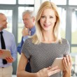 Middle age businesswoman standing — Stock Photo #76594557